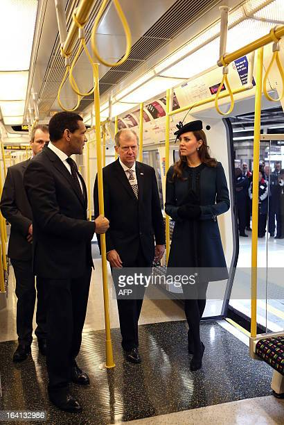 Britain's Catherine Duchess of Cambridge tours a train during a visit to Baker Street tube station in London on March 20 2013 to mark 150th...