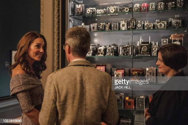 Britain's Catherine Duchess of Cambridge views the Collecting Photography From Daguerreotype to Digital exhibition as she officially opens the new...