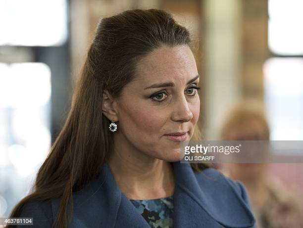 Britain's Catherine Duchess of Cambridge visits the 'Emma Bridgewater' pottery factory to view the production of a mug that the company has launched...