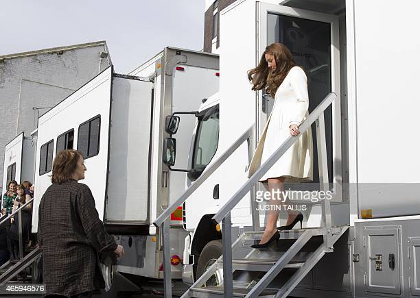 Britain's Catherine Duchess of Cambridge walks out of a make up trailer on the set of British television series Downton Abbey at Ealing Studios in...