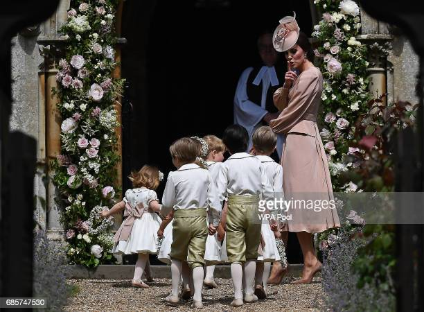Britain's Catherine, Duchess of Cambridge walks with the bridesmaids and pageboys as they arrive as they arrive for her sister Pippa Middleton's...