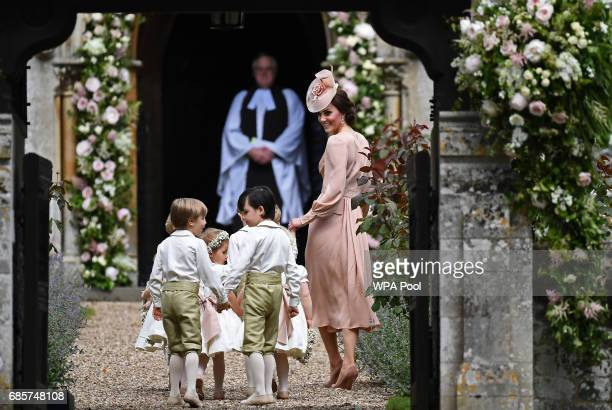 Britain's Catherine Duchess of Cambridge walks with the bridesmaids and pageboys as they arrive as they arrive for her sister Pippa Middleton's...