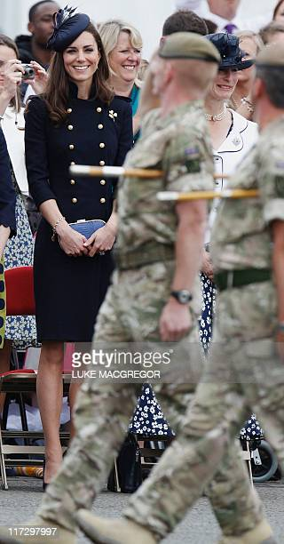 Britain's Catherine Duchess of Cambridge watches a parade of the 1st Battalion Irish Guards with operational medals for Afghanistan on Armed Forces...