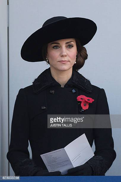 Britain's Catherine Duchess of Cambridge watches from a balcony the Remembrance Sunday ceremony at the Cenotaph on Whitehall London on November 13...