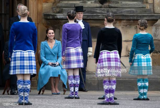 Britain's Catherine, Duchess of Cambridge watches Highland dancers perform during a Beating Retreat by The Massed Pipes and Drums of the Combined...