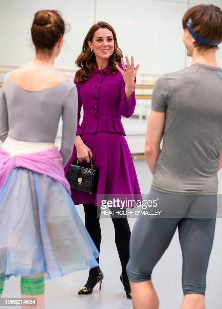 Britain's Catherine Duchess of Cambridge watches Royal Ballet Principal Dancers Lauren Cuthbertson and Vadim Muntagirov during a visit to the Royal...