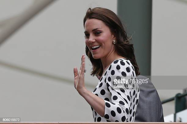 Britain's Catherine Duchess of Cambridge waves as she arrives at The All England Lawn Tennis Club in Wimbledon southwest London on July 3 2017 on the...