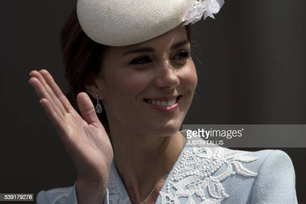 TOPSHOT Britain's Catherine Duchess of Cambridge waves as she leaves after attending a national service of thanksgiving for the 90th birthday of...