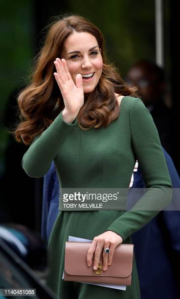 Britain's Catherine, Duchess of Cambridge waves as she visits the Anna Freud National Centre for Children and Families in London on May 1, 2019.