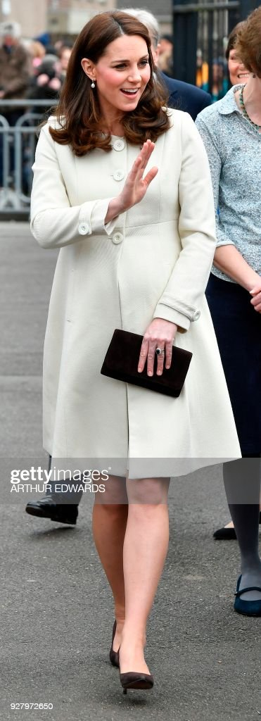 Britain's Catherine, Duchess of Cambridge, waves to waiting school children as she arrives to visit Pegasus Primary School in Oxford, north of London, on March 6, 2018, to learn more about the work of the charity Family Links. Family Links works closely with schools nationwide to support both children and parents with their emotional health and wellbeing, with an emphasis on early intervention. /