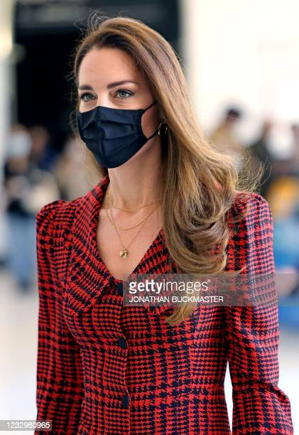 Britain's Catherine, Duchess of Cambridge , wearing a face covering, visits the Victoria and Albert museum in London on May 19 as Covid-19 lockdown...