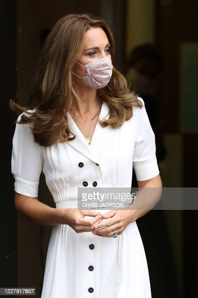 Britain's Catherine, Duchess of Cambridge wearing a face mask or covering due to the COVID-19 pandemic, leaves after her visit to a baby bank in...