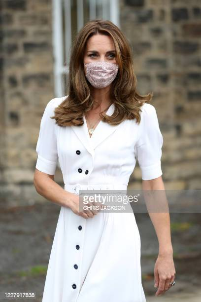 Britain's Catherine Duchess of Cambridge wearing a face mask or covering due to the COVID19 pandemic leaves after her visit to a baby bank in...