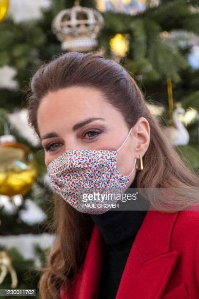 Britain's Catherine, Duchess of Cambridge wearing a protective face covering to combat the spread of the coronavirus, speaks with residents during a...