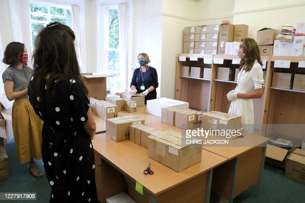 Britain's Catherine, Duchess of Cambridge wears a face mask or covering due to the COVID-19 pandemic, during her visit to Baby Basics baby bank in...