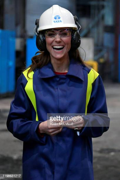Britain's Catherine Duchess of Cambridge wears a hard hat and protective clothe during her visit to the Tata Steel plant in Port Talbot south Wales...