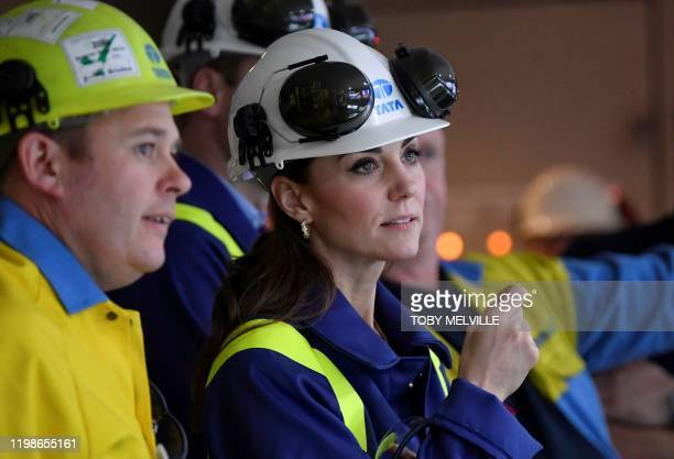 Britain's Catherine Duchess of Cambridge wears a hard hat and protective clothes as she speaks with Works Manager Carl Banfield in the control centre...
