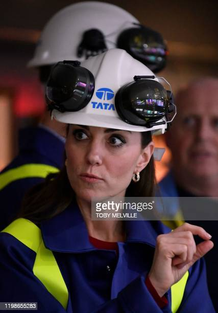 Britain's Catherine Duchess of Cambridge wears a hard hat and protective clothes during her tour of the control centre at Tata Steel plant in Port...
