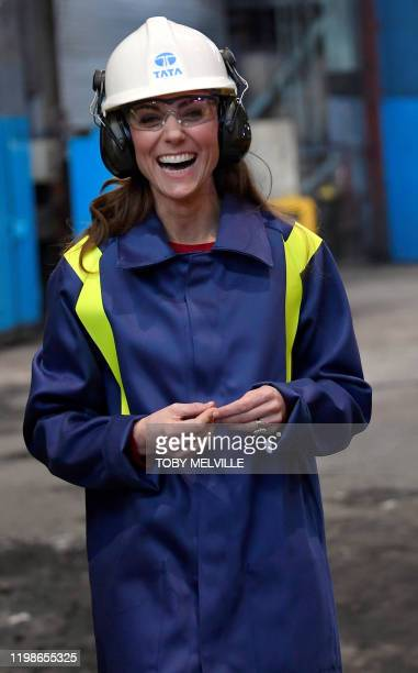 Britain's Catherine Duchess of Cambridge wears a hard hat and protective clothes during her visit to the Tata Steel plant in Port Talbot south Wales...