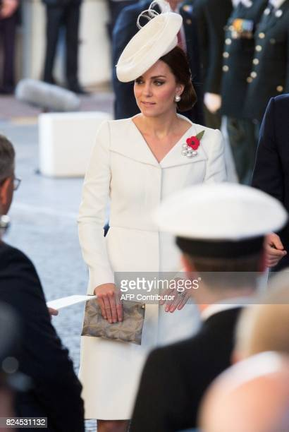 Britain's Catherine the Duchess of Cambridge attends the Last Post ceremony at the Commonwealth War Graves Commission Ypres Memorial at the Menin...