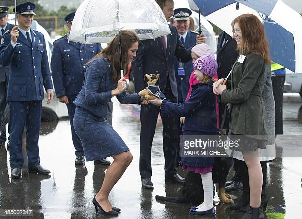 Britain's Catherine the Duchess of Cambridge is given a stuffed dog as she visits the Royal New Zealand Police College in Wellington on the final day...