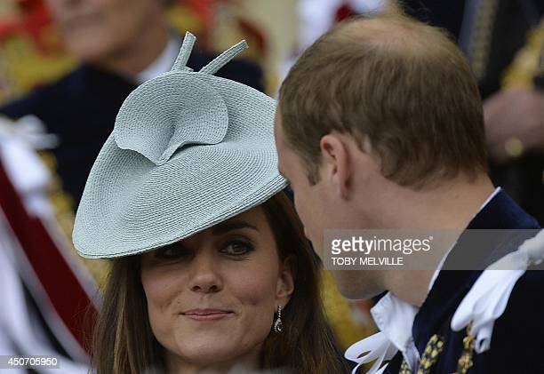 Britain's Catherine the Duchess of Cambridge speaks with her husband Prince William the Duke of Cambridge after attending the Order of the Garter...