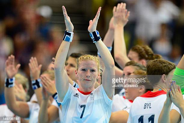 Britain's centreback Lynn Mccafferty applauds after being defeated by Angola at the end of the women's preliminary Group A handball match Angola vs...
