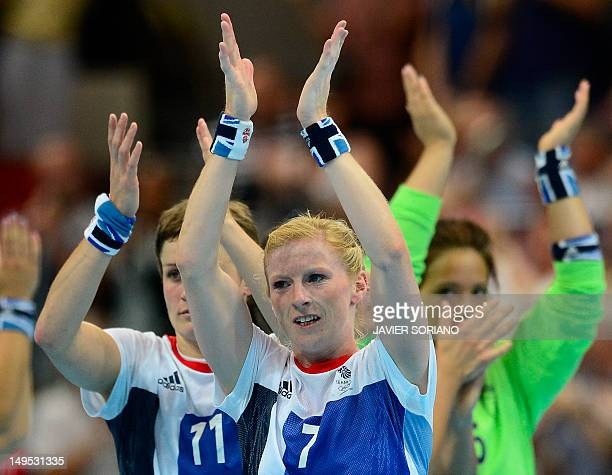 Britain's centreback Lynn Mccafferty applauds at the end of the women's preliminaries Group A handball match Great Britain vs Russia for the London...