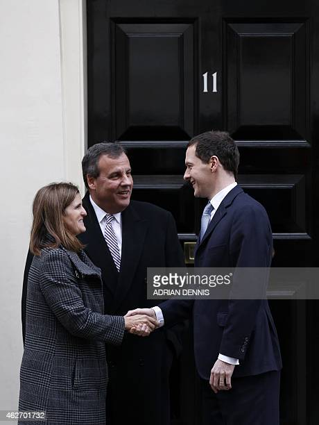 Britain's Chancellor George Osborne bids farewell to US Governor of New Jersey Chris Christie and his wife Mary Pat Christie outside 11 Downing...