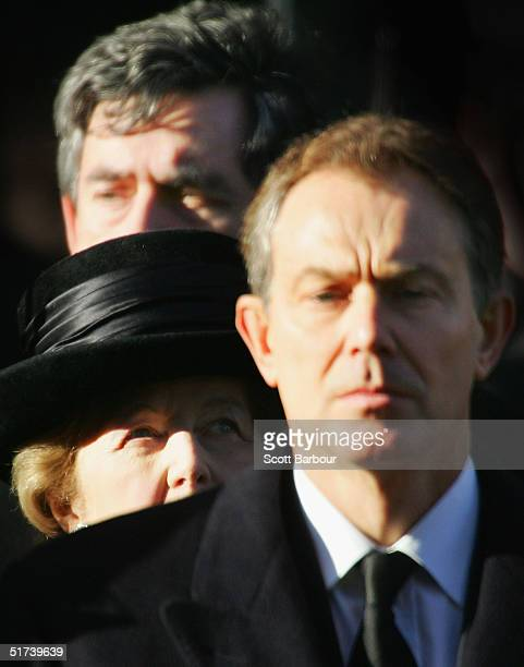 Britain's Chancellor Gordon Brown , Former Prime Minister Margaret Thatcher look over the shoulder of Prime Minister Tony Blair as they stand for a...