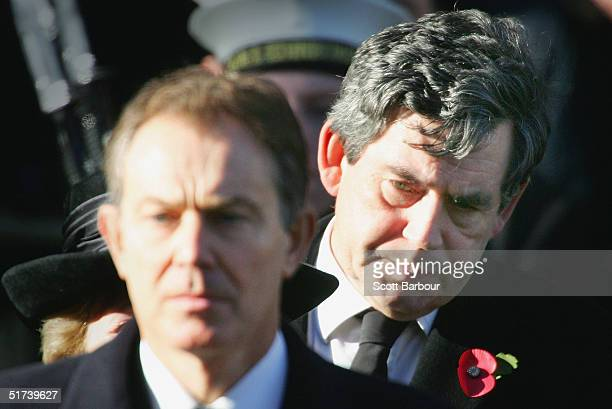 Britain's Chancellor Gordon Brown looks over the shoulder of Prime Minister Tony Blair as they stand for a twominute silence at the annual...