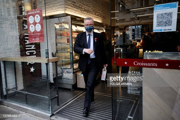 Britain's Chancellor of the Duchy of Lancaster Michael Gove leaves a Pret A Manger shop in central London on November 9, 2020.