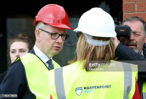 Britain's Chancellor of the Duchy of Lancaster Michael Gove speaks with Clare Guinness Chief Executive Officer of Warrenpoint Harbour on a visit to...