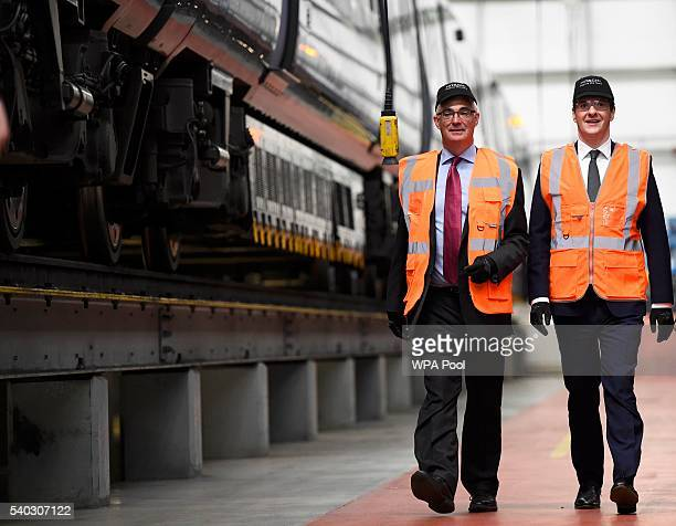Britain's Chancellor of the Exchequer George Osborne and former Chancellor Alistair Darling visit the Hitachi Rail Europe plant after attending a...