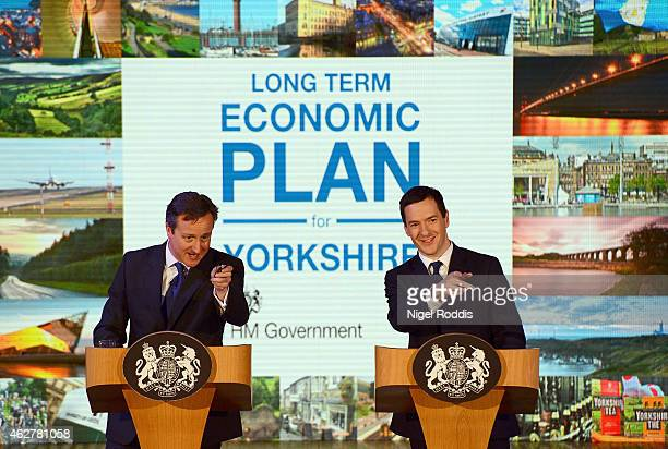 Britain's Chancellor Of The Exchequer George Osborne and Prime Minister David Cameron speak to business leaders at the AQL centreon February 5, 2015...