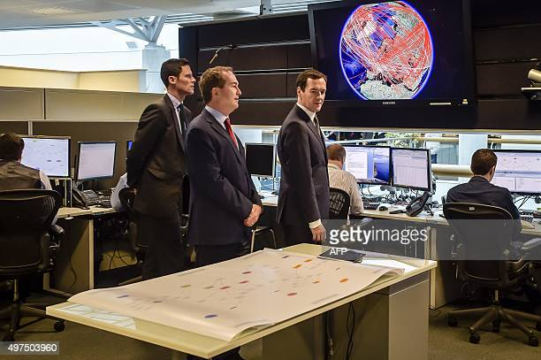 Britain's Chancellor of the Exchequer George Osborne is shown the 24 hour operations room by Director of GCHQ Robert Hannigan and Cheltenham MP Alex...
