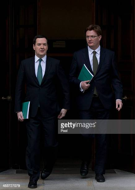 Britain's Chancellor of the Exchequer George Osborne left and his deputy the Chief Secretary to the Treasury Danny Alexander leave the Treasury for...