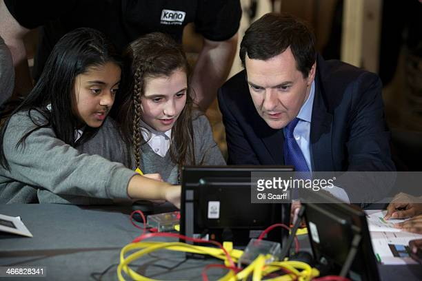 Britain's Chancellor of the Exchequer George Osborne meets students who are learning to write computer code in Royal Society of Arts at the launch of...