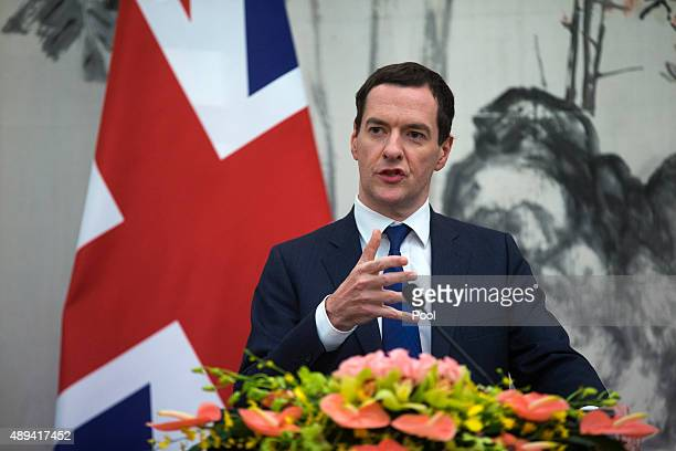 Britain's Chancellor of the Exchequer George Osborne speaks during a joint press conference with Chinese Vice President Ma Kai during the Seventh...