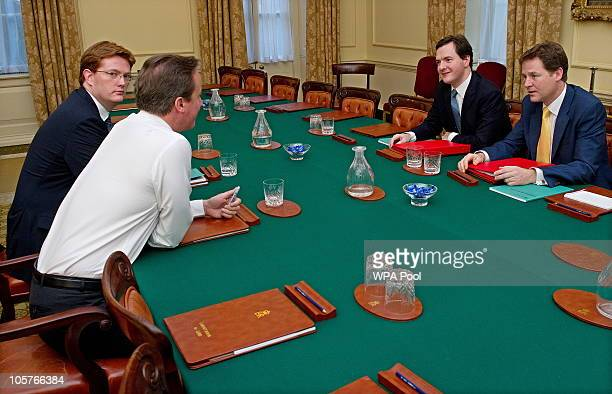 Britain's Chancellor of the Exchequer George Osborne speaks with Deputy Prime Minister Nick Clegg, Chief Secretary to the Treasury Danny Alexander...