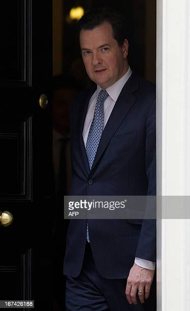 Britain's Chancellor of the exchequer George Osborne walks out of Number 11 Downing st to meet the Chairman of Warner Bros in central London on April...