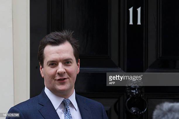 Britain's Chancellor of the exchequer George Osborne walks out of Number 11 Downing st to meet the Chairman of Warner Bros, in central London on...