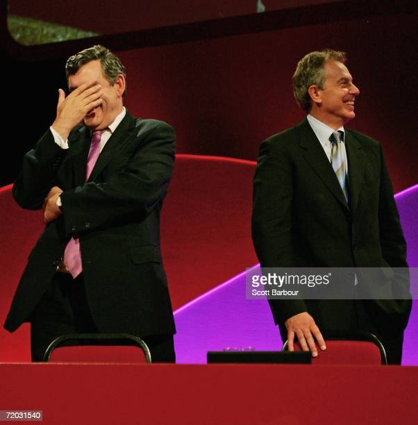 Britain's Chancellor of the Exchequer Gordon Brown and Prime Minister Tony Blair watch a video on the large screen at the Labour Party Autumn...