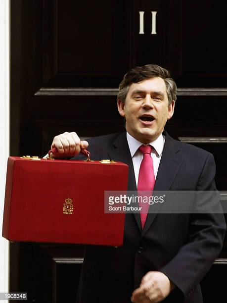 Britain's Chancellor of the Exchequer Gordon Brown holds his briefcase aloft which contains the budget April 9 2003 in London England