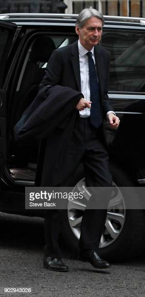 Britain's Chancellor of the Exchequer Philip Hammond arrives at 10 Downing street in central London for the first cabinet meeting of the new year...