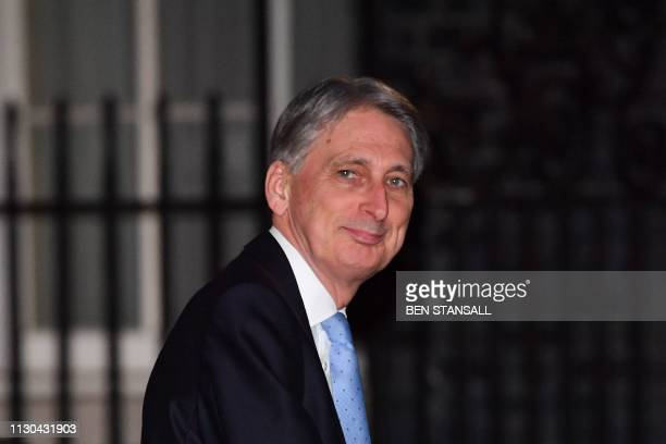 Britain's Chancellor of the Exchequer Philip Hammond arrives at 11 Downing Street from the Houses of Parliament in central London on March 14 2019...