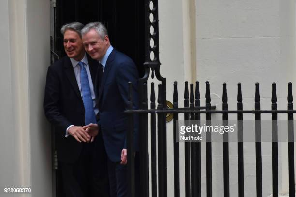 Britain's Chancellor of the Exchequer Philip Hammond bids farewell to France's Finance Minister Bruno Le Maire following their meeting at 11 Downing...