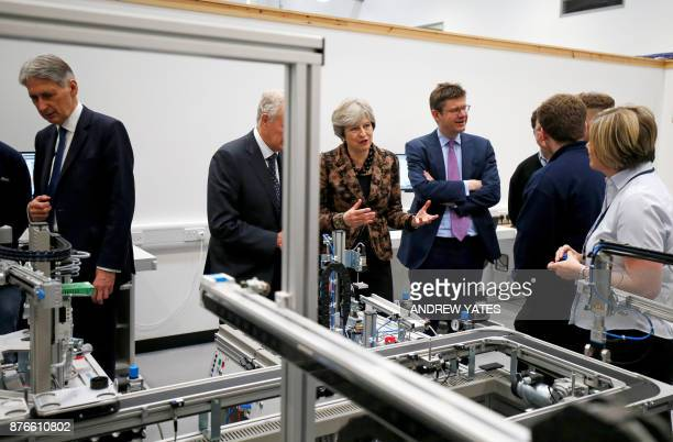 Britain's Chancellor of the Exchequer Philip Hammond Britain's Prime Minister Theresa May and Britain's Business Energy and Industrial Strategy...