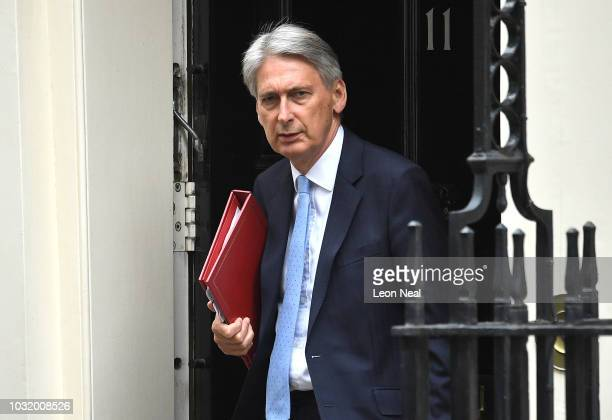 Britain's Chancellor of the Exchequer Philip Hammond leaves number 11 Downing Street ahead of Prime Minister's Question session on September 12 2018...