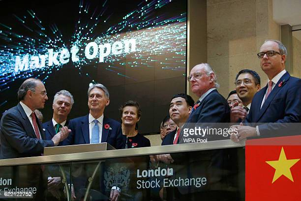 Britain's Chancellor of the Exchequer Philip Hammond opens the London Stock Exchange with Xavier Rolet CEO and joined by a banking and financial...